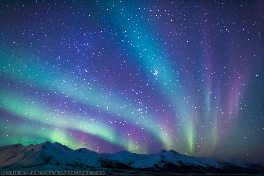 Colorful aurora borealis over the mountains near chandalar shelf, Brooks Range Alaska, hovering over the Arctic National Wildlife Refuge. (Patrick J Endres / AlaskaPhotoGraphics.com)