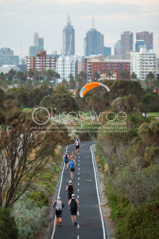 Age Group Competitors Run In Towards The City Of Melbourne And The St Kilda Finish Line. Ironman Asia Pacific Championship Melbourne. Triathlon. Frankston And St Kilda, Melbourne, Victoria, Australia. 24/03/2013. Photo By Lucas Wroe (Lucas Wroe)