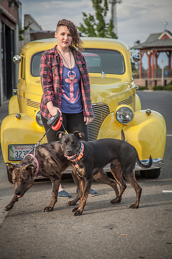 "Customer Care Attendant at Clear Captions, Dayla Pearl with her dogs Luna and Squeaky in Roseville, California  ""I love when people are happy after our phone calls...the service is free and very satisfying.""  (1939 Chevrolet) (© Clark James Mishler)"