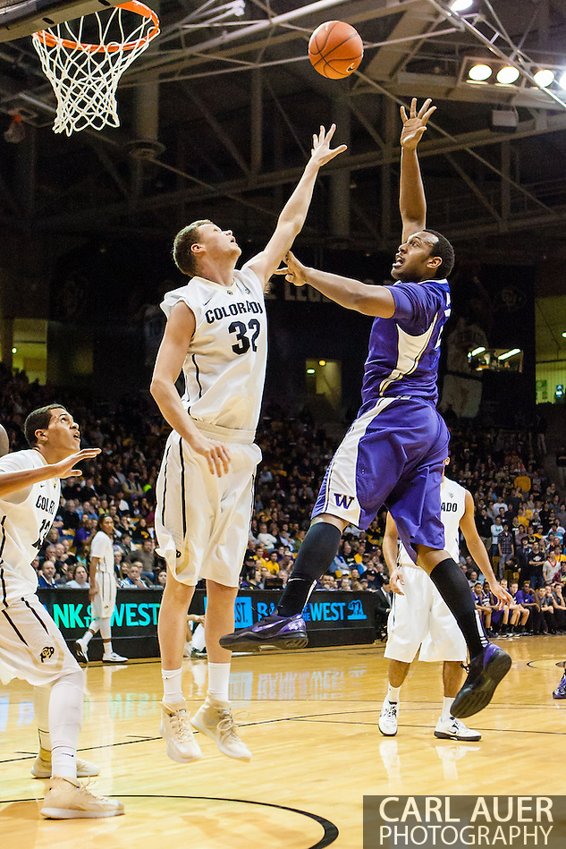 February 9th, 2014:  Washington Huskies senior forward Perris Blackwell (2) throws up a shot over Colorado Buffaloes senior center Ben Mills (32) in the first half of action in the NCAA Basketball game between the Washington Huskies and the University of Colorado Buffaloes at the Coors Events Center in Boulder, Colorado (Carl Auer/ZUMAPRESS.com)