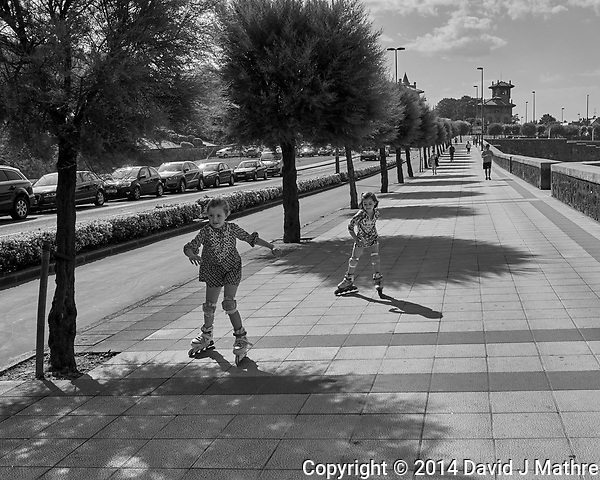 Sidewalk Skaters in Getxo Spain. Image taken with a Leica X2 camera (ISO 100, 24 mm, f/6.3, 1/1250 sec). Raw image processed with Capture One Pro, and Photoshop CC 2014 (David J Mathre)