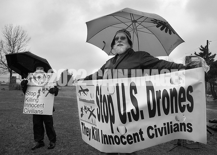 HORSHAM, PA - MARCH 29:  Members of Coalition for Peace Action along with Buddhist Monks march to the Horsham Drone Command Center to protest March 29, 2014 in Horsham, Pennsylvania. (Photo by William Thomas Cain/Cain Images) (William Thomas Cain)