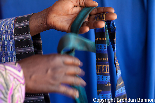 "Peter Olendo keeps a cache of neck ties for customers to  wear at his  photo studio in Kibera.            Olendo also has clip on ties for those ""with no time to waste."" (Brendan Bannon)"