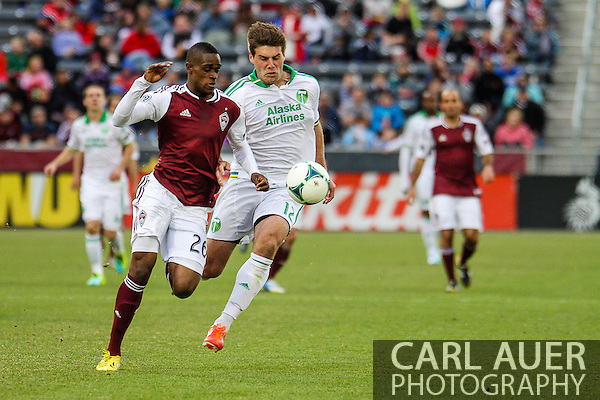 March 30th, 2013 Commerce City, CO - Colorado Rapids forward Deshorn Brown (26) and Portland Timbers defender David Horst (12) chase after the ball in the second half of the MLS match between the Portland Timbers and the Colorado Rapids at Dick's Sporting Goods Park in Commerce City, CO (Carl Auer/Newsport)