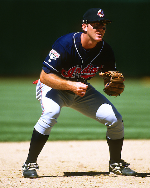 OAKLAND - 1995:  Jim Thome #25 of the Cleveland Indians fields during an MLB game against the Oakland Athletics at he Oakland-Alameda County Colosseum.  Thome played for the Indians from 1991-2002.  (Photo by Ron Vesely) (Ron Vesely)