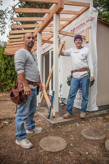 Tommy Gutierrez and Bret Heywood take a break from converting a shed into my office in Calistoga. (Clark James Mishler)