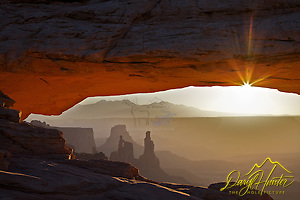 "Mesa  Arch, Sunrise, Canyonlands, National Park, Moab, Utah (Daryl Hunter's ""The Hole Picture"" ? Daryl L. Hunter has been photographing the Yellowstone Region since 1987, when he packed up his view camera, Pentex 6X7, and his 35mm?s and headed to Jackson Hole Wyoming. Besides selling photography Daryl also publishe)"