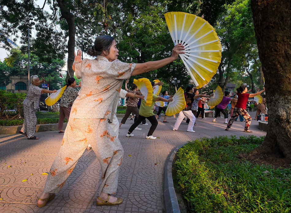 HANOI, VIETNAM - CIRCA SEPTEMBER 2014:  Vietnamese woman exercising early morning in the Hoan Kiem Lake, in Hanoi. (Daniel Korzeniewski)