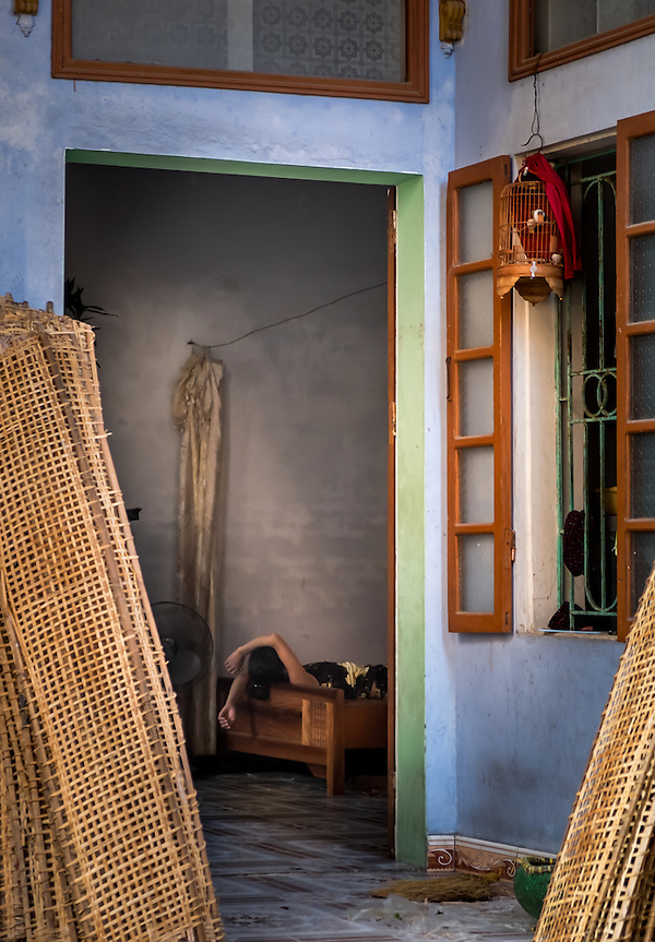 VAN HA, VIETNAM - CIRCA SEPTEMBER 2014:  Woman taking a nap inside her house at the Lang Gom Tho Ha village. The village belongs to the Van Ha commune, it is located 50km away from Hanoi in Northern Vietman (Daniel Korzeniewski)