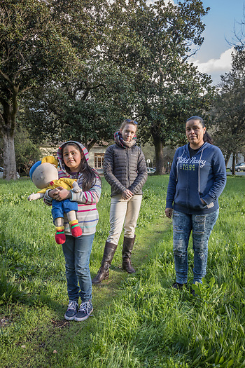 Hotel housekeeper and Calistoga resident Jazmine Rodrigues pauses near Lincoln Avenue with her seven year old daughter, Ashley, and family friend, Kathy Scott. (Clark James Mishler)