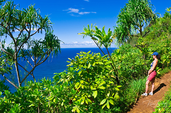 Hiker on the lush Kalalau Trail on the Na Pali Coast, Island of Kauai, Hawaii (Russ Bishop/Russ Bishop Photography)
