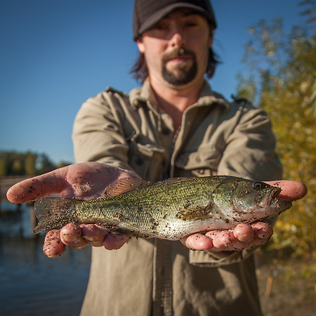 """Michael Johnson, originally from Eagle River, Alaska tries his luck at Wapato Lake in Tocoma, WA.  Clark and Mitzi's move from Anchorage, Alaska to Calistoga, California, September, 2015  """"I like to live near the coast...if I could be anything, I would like to be a fishing guide...fishing has always been my favorite past time.""""  mountainleo@yahoo.com (© Clark James Mishler)"""