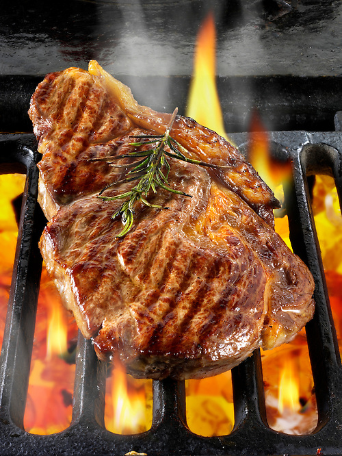 Sirloin beef steaks being cooked on a bbq. Meat food photos, pictures &amp; images. (Paul Randall Williams)