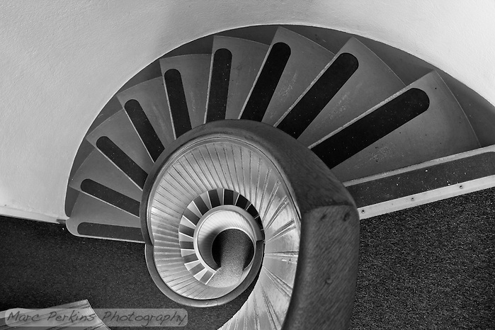 Lighthouse staircases are just plain awesome, and Old Point Loma Light's stairway in Cabrillo National Monument is no exception.  Greg and I spent a good half hour up at the top trying various compositions, waiting for people to stop walking in, and admiring the Nautilus-like stairway.  To bring out the textures and lines I prefer this in black and white, especially since the colors aren't particularly grabbing. (Marc C. Perkins)
