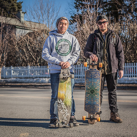 "Dimond High seniors and long-boarders David Tinilla and Justin Camillo on Tenth Avenue near G Street, Anchorage.                   ""Like most Alaskans I fish, camp, and hunt in the summer time but I'm also quite fond of my city...I often hear my peers claiming there's nothing to do here, or that we lack culture.  As an Anchorage youth I believe it's our responsibility to work with our given circumstances to make the best of it.  Anchorage started as a tent city, a city of canvases you might say.  I think we should paint our picture and leave an imprint.  With longboarding, it's not so much the transportation that makes it great, it's the freedom."" ir1_93@hotmail.com (© Clark James Mishler)"