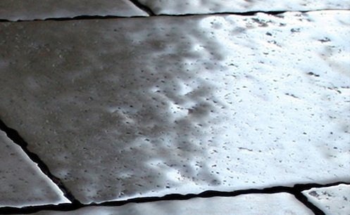 Solid Limestone Tiles with hand-cut edge, partially bush hammered surface and consumed natural undulated, time worn finish. Shown in grey. Please call for color and size availability. (New Ravenna Mosaics)