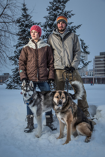 Breanne Hovley and James Long with their dogs, Conan and Dirk, on the Delaney Park Strip, Anchorage (Clark James Mishler)