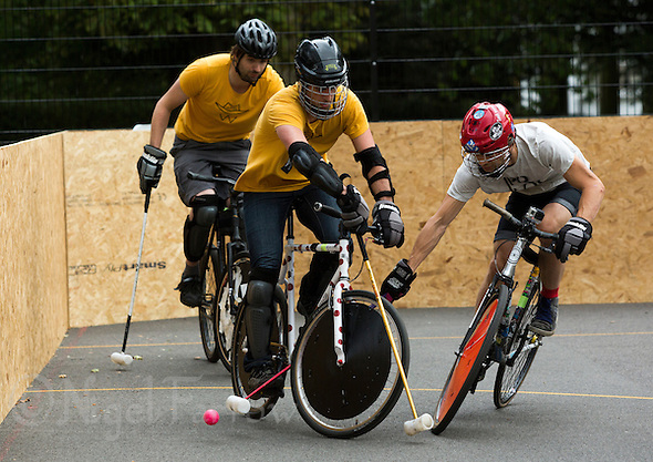 17 AUG 2014 - LONDON, GBR - Players from Westway (in yellow) and Poloski (in cream) battle for the ball during the 2014 London Open Bike Polo tournament at Highbury Fields in London, Great Britain (PHOTO COPYRIGHT © 2014 NIGEL FARROW, ALL RIGHTS RESERVED) (NIGEL FARROW/COPYRIGHT © 2014 NIGEL FARROW : www.nigelfarrow.com)