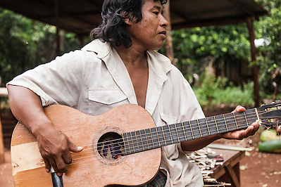 Arturo Duarte, chief of Andresito Mbya Guarani village near San Ignacio, Misiones, Argentina, playing the guitar. (Jason Rothe)