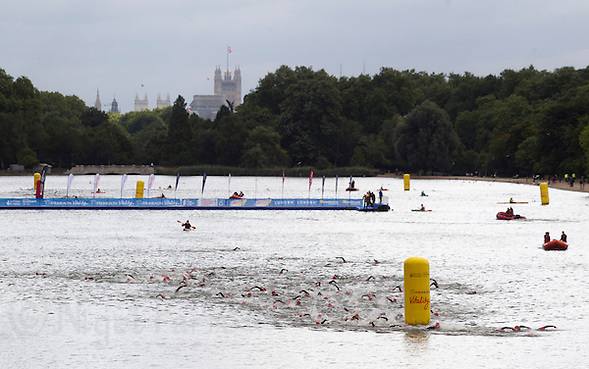 11 SEP 2013 - LONDON, GBR - Competitors turn the first buoy during their 2013 ITU World Aquathlon Championships swim in The Serpentine in Hyde Park in London, Great Britain (PHOTO COPYRIGHT © 2013 NIGEL FARROW, ALL RIGHTS RESERVED) (NIGEL FARROW/COPYRIGHT © 2013 NIGEL FARROW : www.nigelfarrow.com)