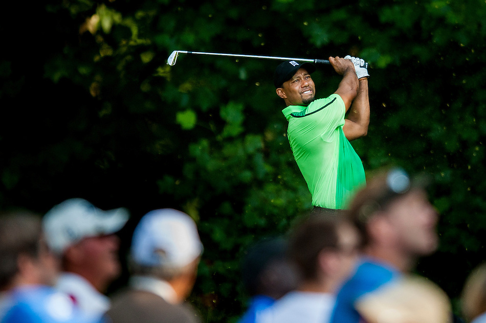 Tiger Woods tees off on the 13th hole during the first round of the Quicken Loans National golf tournament on Wednesday at Congressional Country Club in Bethesda, Maryland. This marked  Woods' return to competition for the first time in three months after having surgery just a week before the Masters in April of this year. (Pete Marovich/Corbis)
