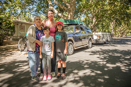 """We're ten minutes away from heading to Montana for a two week camping trip."" -Mutt Lynch Winery owner Brenda Lynch with her kids Porter and Katie and their nanny in front of her home in Calistoga.Calistoga (Clark James Mishler)"
