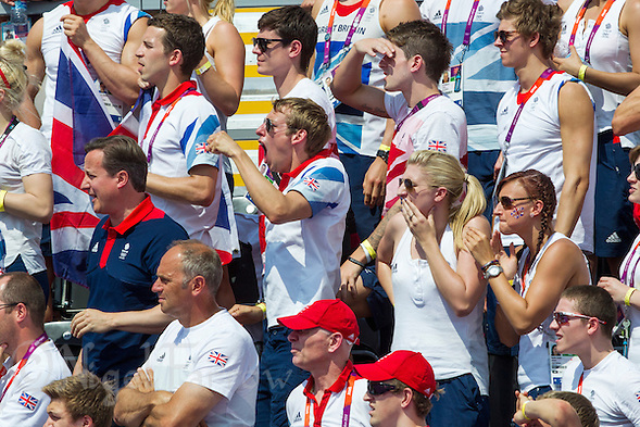 09 AUG 2012 - LONDON, GBR - David Carry (second from left on centre row), the fiance of competitor Keri-Anne Payne, watches the finish of the London 2012 Olympic Games women's 10km Marathon Swimming in Hyde Park, London, Great Britain with British Prime Minister David Cameron (left in centre row), Rebecca Adlington (centre row, second from right) and Sophie Allen (centre row on right) .(PHOTO (C) 2012 NIGEL FARROW) (NIGEL FARROW/(C) 2012 NIGEL FARROW)