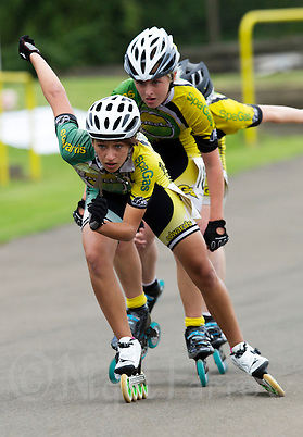 11 AUG 2013 - BIRMINGHAM, GBR - Paige Aitken leads Birmingham Wheels Roller Speed Club team mates Kirsty Pullen (centre) and Tiffany James (hidden) during the Junior Girls 5,000m Points final during the Federation of Inline Speed Skating 2013 British Outdoor Championships at Birmingham Wheels Park in Birmingham, West Midlands, Great Britain (PHOTO COPYRIGHT © 2013 NIGEL FARROW, ALL RIGHTS RESERVED) (NIGEL FARROW/COPYRIGHT © 2013 NIGEL FARROW : www.nigelfarrow.com)