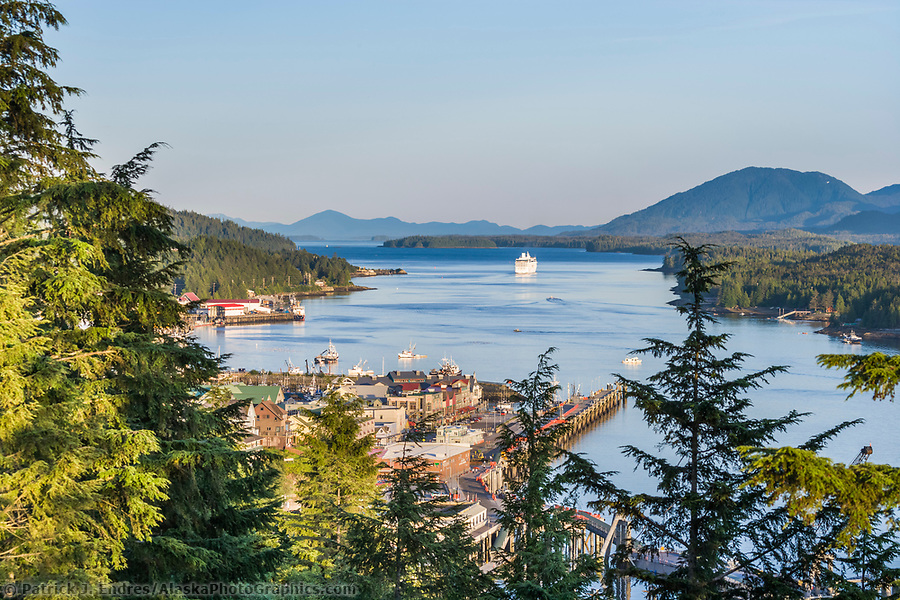 Ketchikan Alaska photos: Overview of downtown Ketchikan, Pennock Island, and the Tongass Narrows. Cruise ship departs to the southeast. (Patrick J. Endres / AlaskaPhotoGraphics.com)