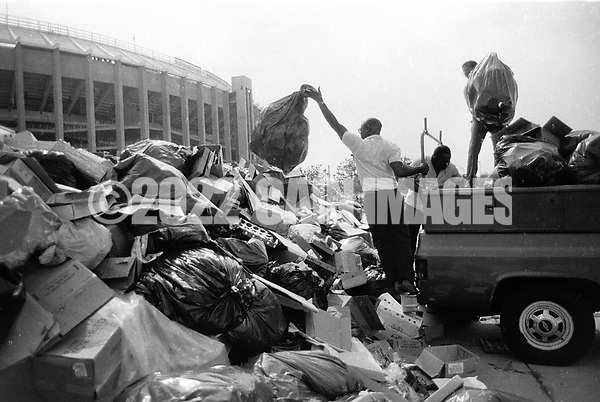A man unloads trash into piles next to Veteran's Stadium in August 1986 during a municipal worker strike in Philadelphia, Pennslyvania. During the 20 day strike, that started July 10, 1986, about 20,000 tons of trash piled up across the city. (Photo by William Thomas Cain/Cain Images) (William Thomas Cain)