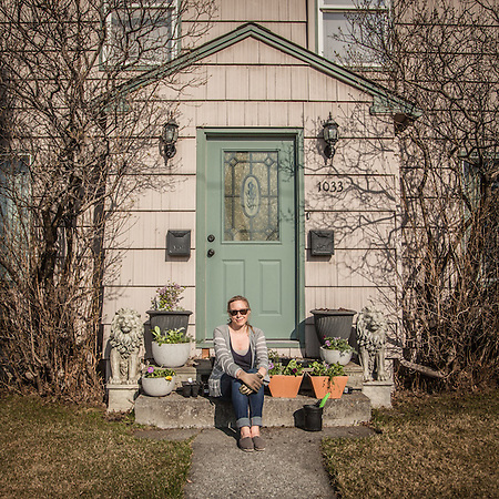 "Contract Coordinator for the Italian Oil Company ENI, Carrie Schnell prepares  flower boxes for the front of her home on E Street in downtown Anchage.  ""My boyfriend and I rent this home from my grandmother.  She has owned it forever.""  carrieschnell@gmail.com (© Clark James Mishler)"