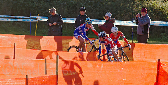 03 NOV 2012 - IPSWICH, GBR - Helen Wyman (GBR) (centre) of Great Britain leads Sanne van Paassen (NED) (right) of the Netherlands and British team mate Nikki Harris (GBR) (left) through a zig-zag section of the course during the elite women&#039;s European Cyclo-Cross Championships in Chantry Park, Ipswich, Suffolk, Great Britain. Wyman won the event after a sprint finish with van Paassen in a time of 43 minutes and 52 seconds making her the first Briton to win a senior international cyclo cross championship .(PHOTO (C) 2012 NIGEL FARROW) (NIGEL FARROW/(C) 2012 NIGEL FARROW)