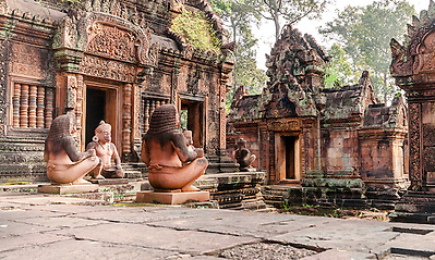 Banteay Srei is a 10th-century Cambodian temple dedicated to the Hindu god Shiva. Located in the area of Angkor in Cambodia. It lies near the hill of Phnom Dei, 25 km north-east of the main group of temples that once belonged to the medieval capitals of Yasodharapura and Angkor Thom. (unknown)