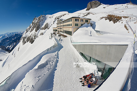 LUCERN, SWITZERLAND - FEBRUARY 21, 2012: Unidentified people sunbathe at the terrace of the Pilatus-Kulm luxury hotel at the top of the Pilatus mountain in Lucern, Switzerland. (Dmitry Chulov)