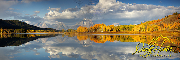 "Grand Teton Panorama at Oxbow Bend where the Snake River provides calm waters for full reflections of Fall colors and and the Grand Tetons. (Daryl Hunter's ""The Hole Picture"" � Daryl L. Hunter has been photographing the Yellowstone Region since 1987, when he packed up his view camera, Pentex 6X7, and his 35mm�s and headed to Jackson Hole Wyoming. Besides selling photography Daryl also publ/Daryl L. Hunter)"