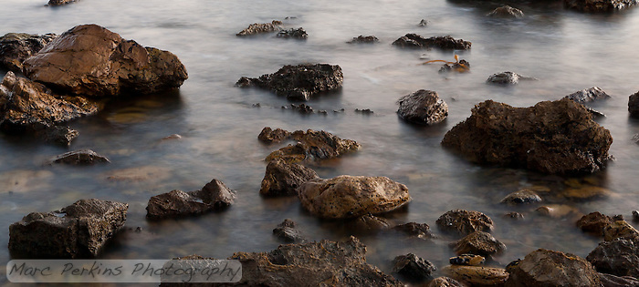 Water turns into a silky smooth sheen in a long-exposure shot of the rocky intertidal at Little Corona Beach in Corona Del Mar (Newport Beach), CA. (Marc C. Perkins)