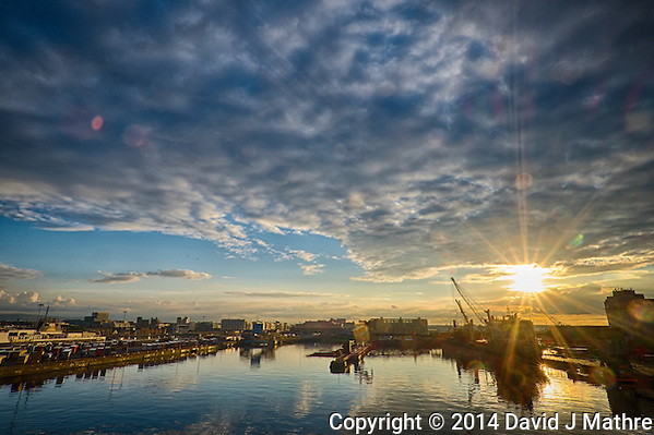 Sunset over the Port of Dublin from the Deck of the MV Explorer. Semester at Sea, Summer 2014 Voyage. Composite of 3 images taken with a Fuji XT1 camera and Zeiss 12 mm f/2.8 lens (ISO 200, 12 mm, f/16). Raw image processed with Capture One Pro, Nik HDR Efex Pro, Nik Define, and Photoshop CC 2014. (David J Mathre)