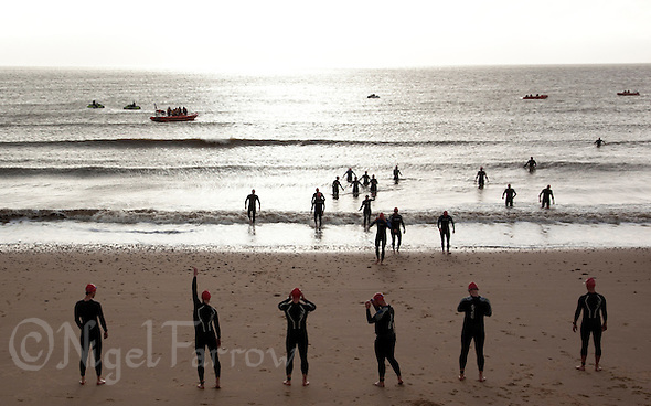 26 SEP 2010 - CLACTON, GBR - Competitors wait for the start of their wave at the Clacton Standard Distance Triathlon .(PHOTO (C) NIGEL FARROW) (NIGEL FARROW/(C) 2010 NIGEL FARROW)