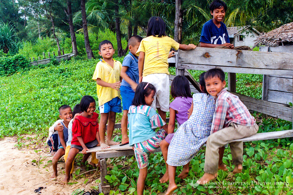 Kalimantan, Tanjung Datu. Small village close to the Malaysian border. As usual in Indonesia there are happy, playfull children everywhere. (Bjorn Grotting)