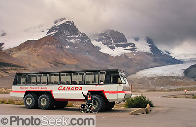 A glacier bus dwarfs a bicyle at Columbia Icefield Visitor Center in Jasper National Park, CANADA.