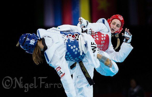 10 AUG 2012 - LONDON, GBR - Carmen Marton (AUS) (right) of Australia aims a kick at Elin Johansson of Sweden during their women's -67kg category quarter final contest at the London 2012 Olympic Games Taekwondo at Excel in London, Great Britain .(PHOTO (C) 2012 NIGEL FARROW) (NIGEL FARROW/(C) 2012 NIGEL FARROW)