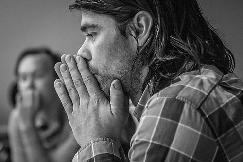 Nick Lehman contemplates Susan Bernstien's comments during her photo workshop at the Anchorage Museum. (© Clark James Mishler)