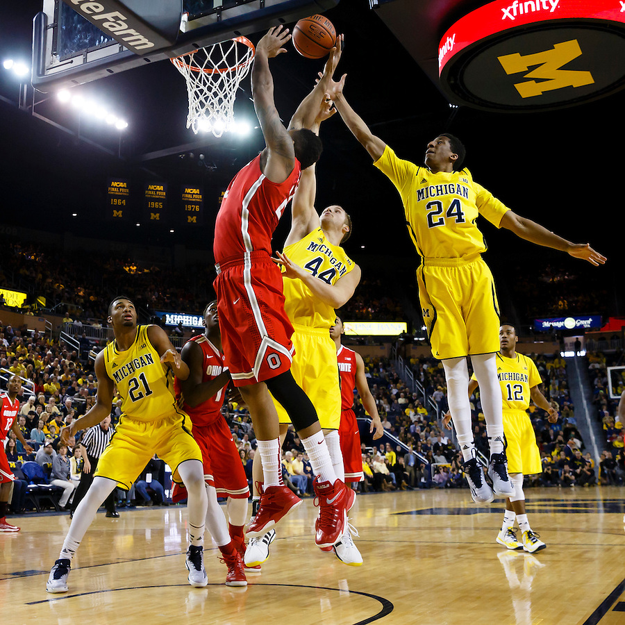 Feb 22, 2015; Ann Arbor, MI, USA; Ohio State Buckeyes center Amir Williams (23) is fouled by Michigan Wolverines forward Max Bielfeldt (44) in the second half at Crisler Center. Michigan won 64-57. Mandatory Credit: Rick Osentoski-USA TODAY Sports (Rick Osentoski/Rick Osentoski-USA TODAY Sports)