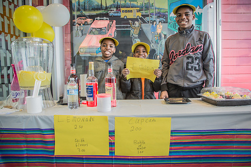 Brothers DeAndre, Macaeenan, and William Morgan, attend their Lemonade stand at Credit Union One in the Mountain View neighborhood of Anchorage (Clark James Mishler)
