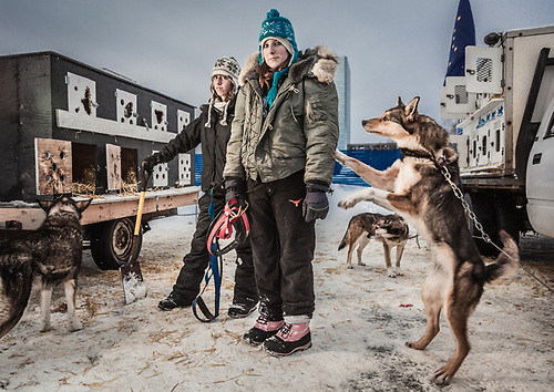 Dog Handlers, Jackie Honeycut and Katey Miracle, with High Country Kennels, assist with public sled dog rides on the Delaney Parkstrip in downtown Anchorage. (Clark James Mishler)