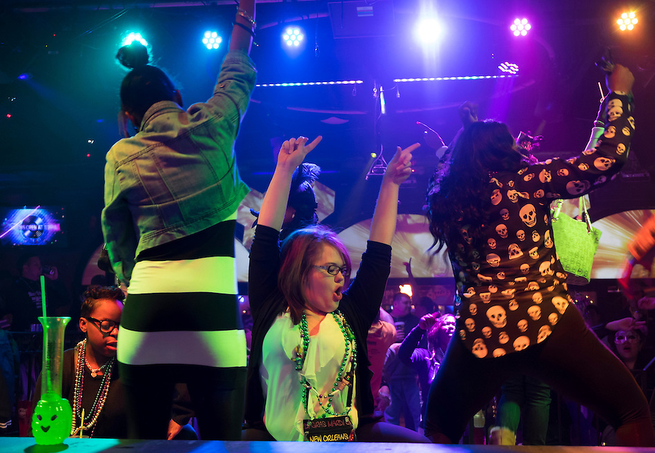 NEW ORLEANS - CIRCA FEBRUARY 2014: People dancing and celebrating Mardi Mardi Gras at a nightclub in the French Quarter in New Orleans (Daniel Korzeniewski)