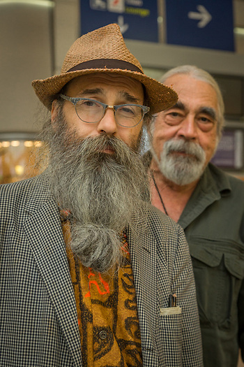 Ohio artist Joe Bluesky and art dealer Eric Schickendantz await their flight home at the Charles de Gualle Airport in  Paris, France (Clark James Mishler)