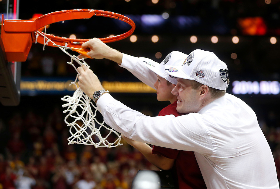 Iowa State head coach Fred Hoiberg, accompanied by his son, Sam,  cuts down the net after winning the Big 12 championship Saturday, March 15, 2014 in Kansas City, Mo. (Christopher Gannon/The Register)