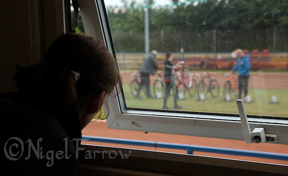 14 JUN 2015 - IPSWICH, GBR - Helen Clancy, the mother of Ipswich Eagles rider Lewis Roberts watches preparations for the Elite League fixture against Poole Comets at Whitton Sports and Community Centre in Ipswich, Suffolk, Great Britain from the clubs cafe. She rarely watches Lewis ride (PHOTO COPYRIGHT © 2015 NIGEL FARROW, ALL RIGHTS RESERVED) (NIGEL FARROW/COPYRIGHT © 2015 NIGEL FARROW : www.nigelfarrow.com)
