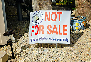 "A ""not for sale"" sign stands outside a condominium, Sept. 27, 2019, in Mexico Beach, Florida. Nearly half the town's 1,900 homes were damaged or destroyed by the category five hurricane. Many homeowners remain in limbo as they wait for money from their insurance companies or the Federal Emergency Management Agency to pay for repairs or demolition. Some residents say there is tension among those who have chosen to sell their properties and those who have chosen to stay and rebuild. (Photo by Carmen K. Sisson/Cloudybright) (Carmen K. Sisson/Cloudybright)"